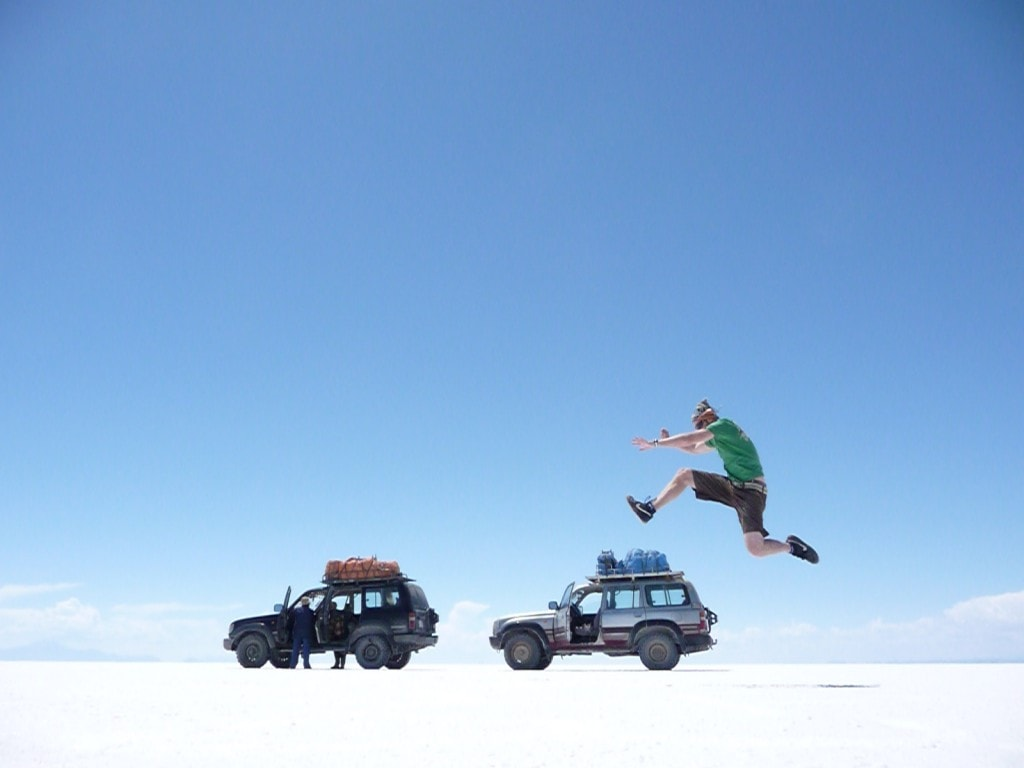 Jumping two land cruisers on the salt flats of Bolivia