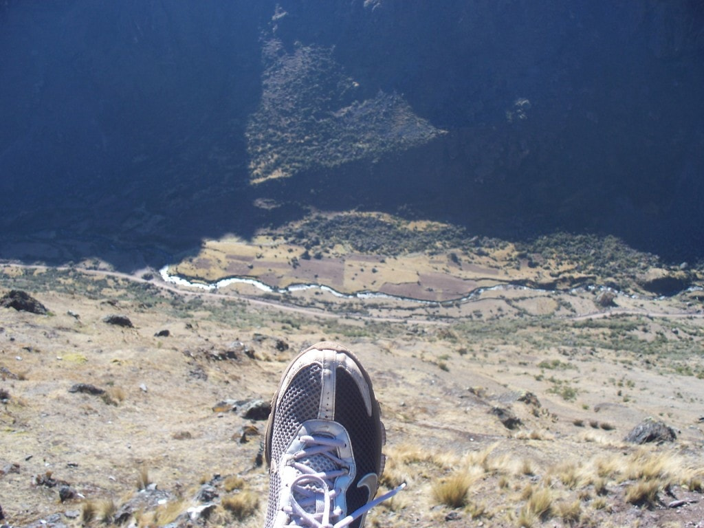 The Lares trek features some very impressive trails that lead along very steep cliffs.  Here I hang my foot over the edge to show the depth of the valley.