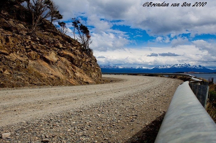 A road winds towards the end of the world, el fin del mundo, and then turns a corner