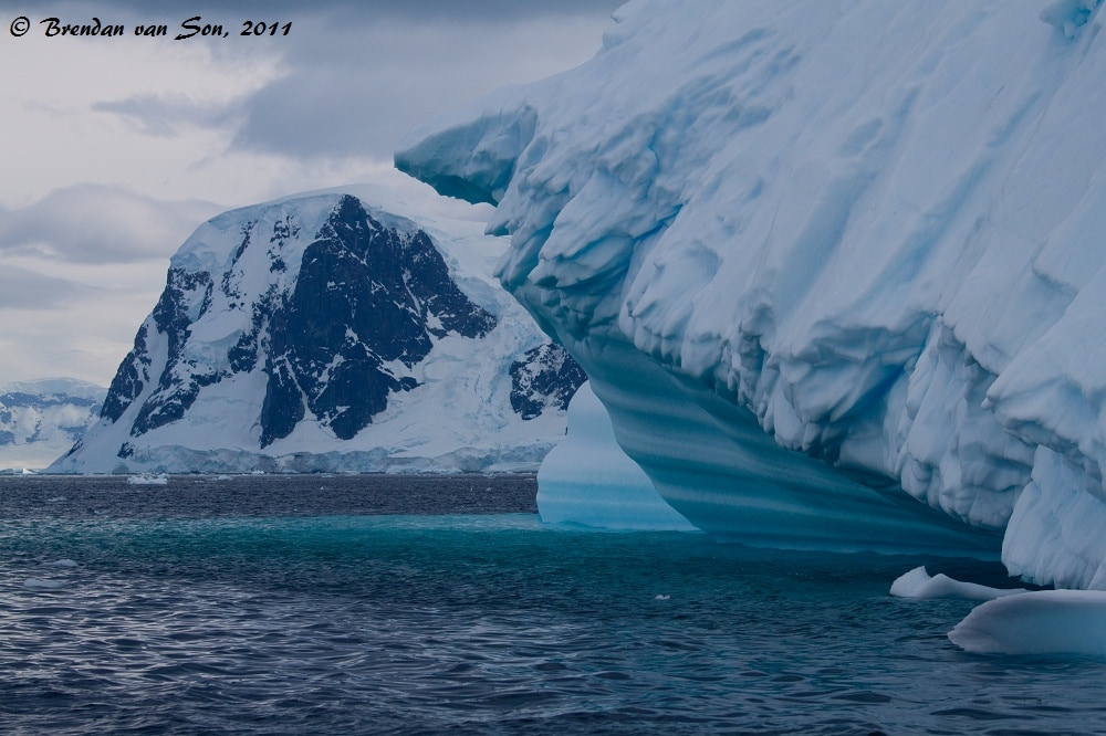 If the ice wasn't amazing enough, the mountains in the background are spectacular.  After photographing ice in Antarctica for a while, photographers start to get greedy looking for not only ice, but ice with mountains or animals.
