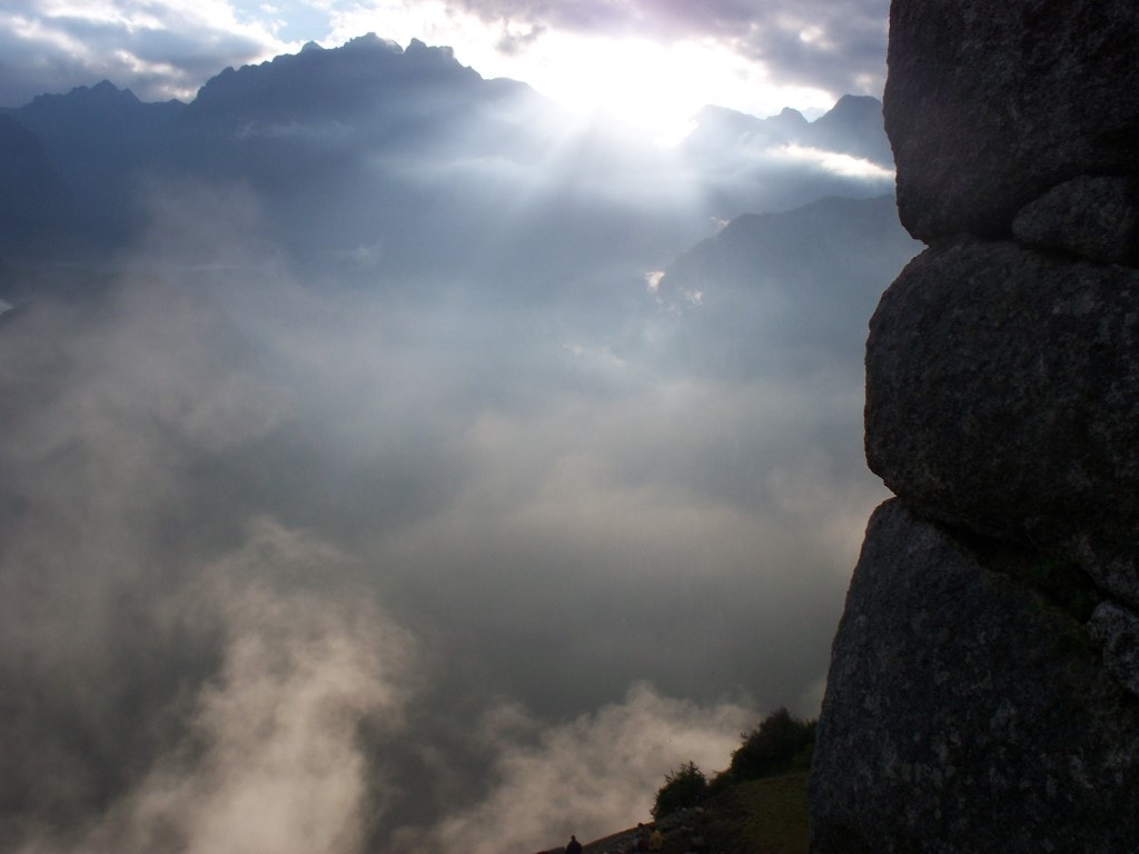 This is one of the pictures that I'm most proud of. As all the people were focused on looking out at Wayna Picchu I turned to the right to see the sun breaking through over the mountains. The rocks on the side are part of the watchtower of Machu Picchu which is one of the best places to watch the fog lift from the site itself.