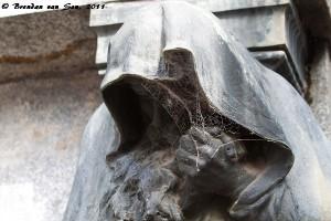 Spider web on statue, La recoleta, buenos aires, argetina