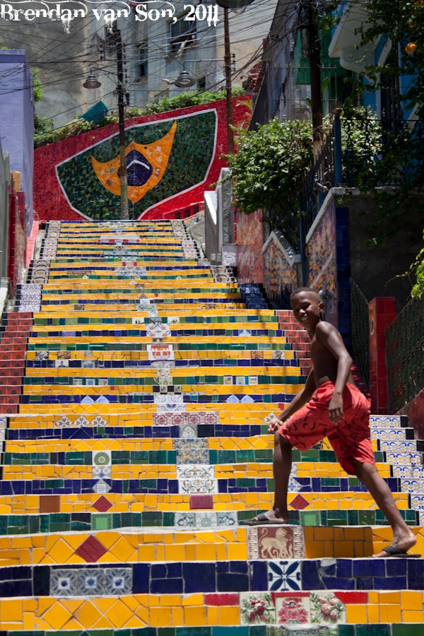 Boy climbing the famous Escalera de Selaron in Rio de Janerio
