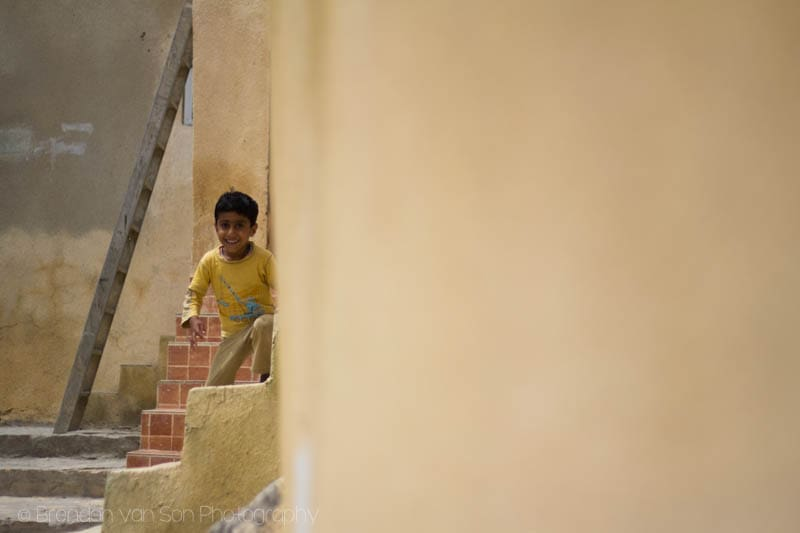 Boy playing in Oman Village