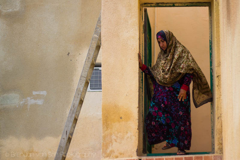 A woman in Oman leaving her home.