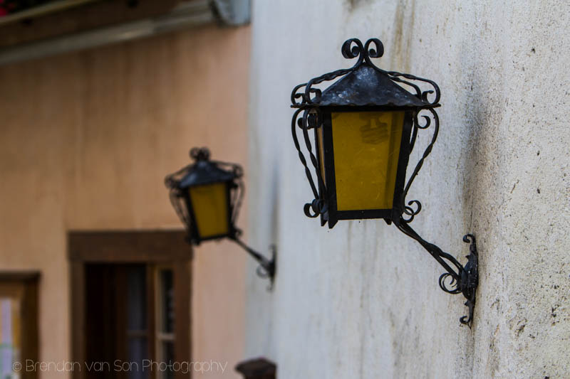 Old street lights along the stone walls of the old town. Shot at 85mm, f/3.5, 1/800sec., ISO 100