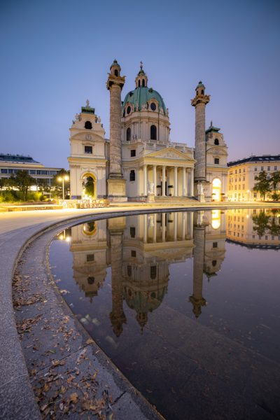Vienna's karl's church at dawn with a reflecting pool